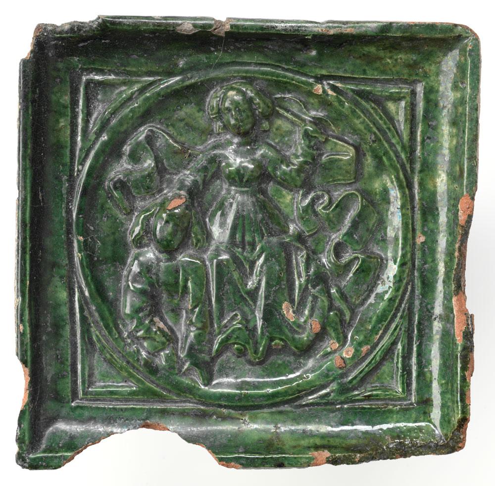 Grün glasierte Ofenkachel mit dem Motiv des Philosophenritts.