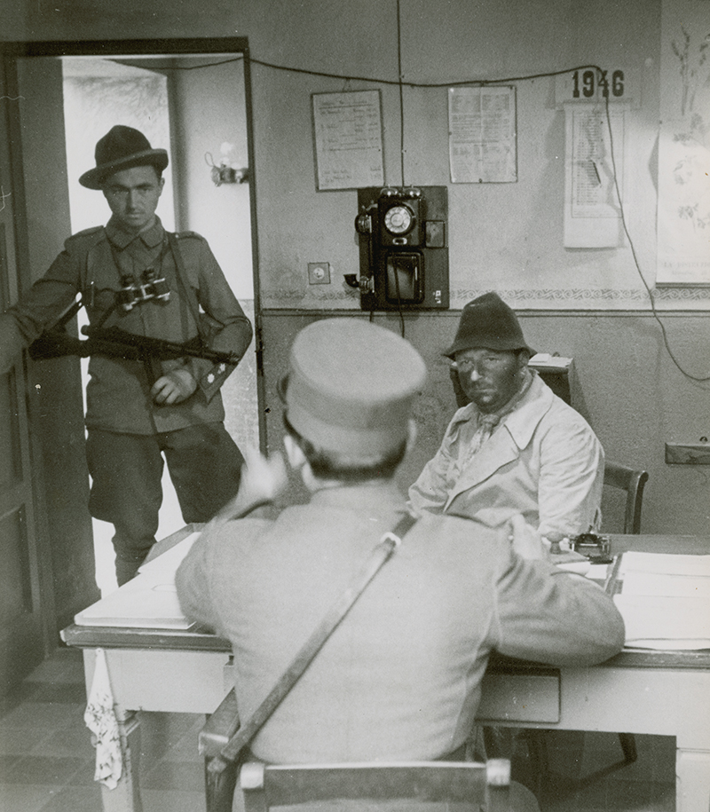 A smuggler being interrogated.