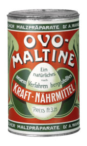 The first Ovomaltine tin from 1904 didn't yet feature the characteristic orange colour.