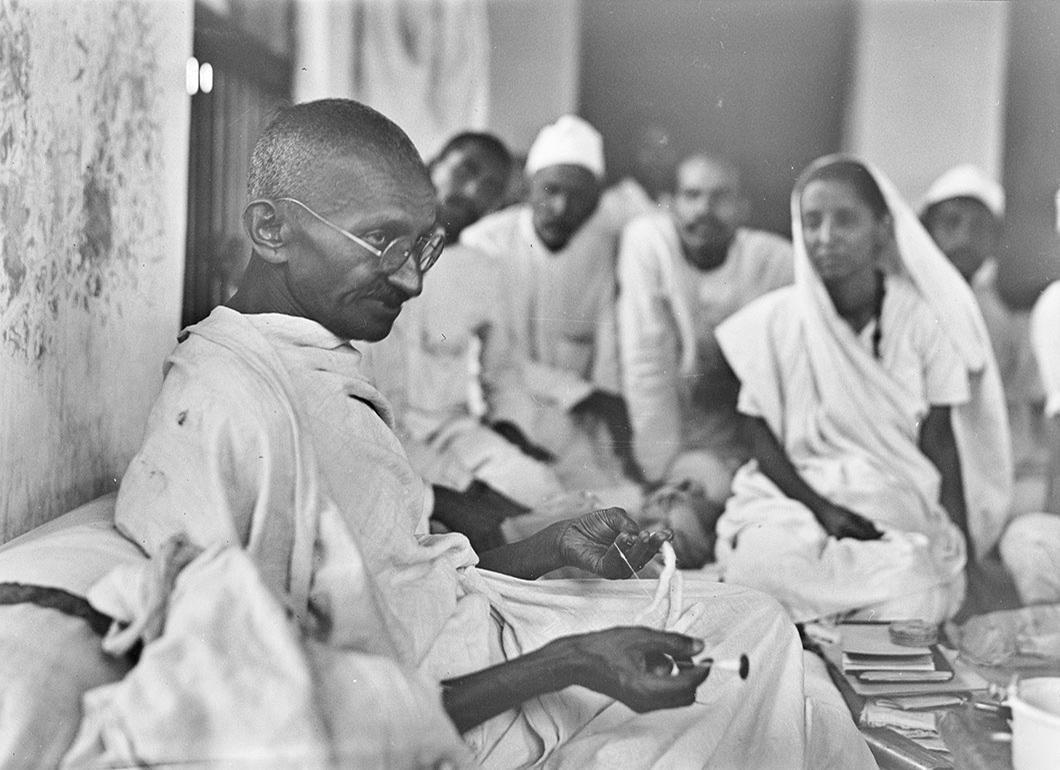 Gandhi at his spinning. Photo: Walter Bosshard
