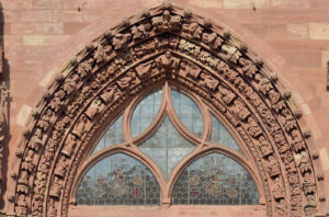 Basel Cathedral, tympanum over the main portal; up until the iconoclasm of 1529 probably featuring a depiction of the Last Judgement, replaced in 1597 with fine Gothic tracery (ornamentation).