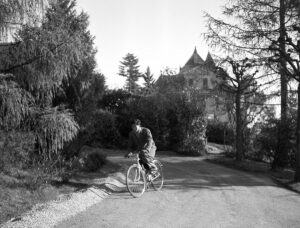 Bhumibol on his bicycle in front of Villa Vadhana in Pully, where the family lived, early 1940s.