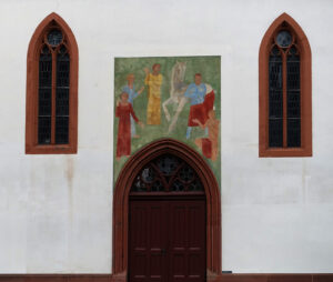 Hans Friedrich Rohner (1898-1972), mural of the legend of St Martin above the south portal of St Martin's Reformed Church in Basel, 1922. To this day Martin has retained his status as a symbol of compassion, across denominational boundaries.