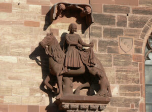 Basel Cathedral, Martin cutting his cloak; copy dating from 1883, original late 14th century, now in the Museum Kleines Klingental. Both statues were originally painted.