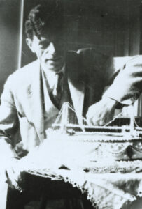 Othmar Ammann with a model of the George Washington Bridge, around 1925-1940.