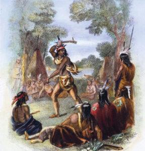 Le chef indien Pontiac (1720-1769) qui prit la tête de la révolte indienne de 1763 contre les troupes anglaises, à la hache de guerre, 1763. Gravure colorée par un artiste inconnu du XIXe siècle.