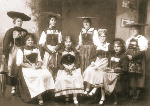 Swiss women in traditional dress, early 20th century.